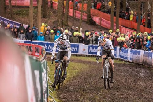 Mathieuness vs. Woutness up one of the muddy drags in Hoogerheide.