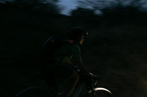 Lael rides into the night. Mile 93.5 of the AZT 300. (Rugile Kaladyte)