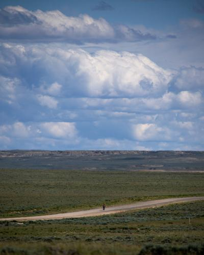 Lael Wilcox and rides towards Wamsutter, Wyoming. (Rugile Kaladyte)