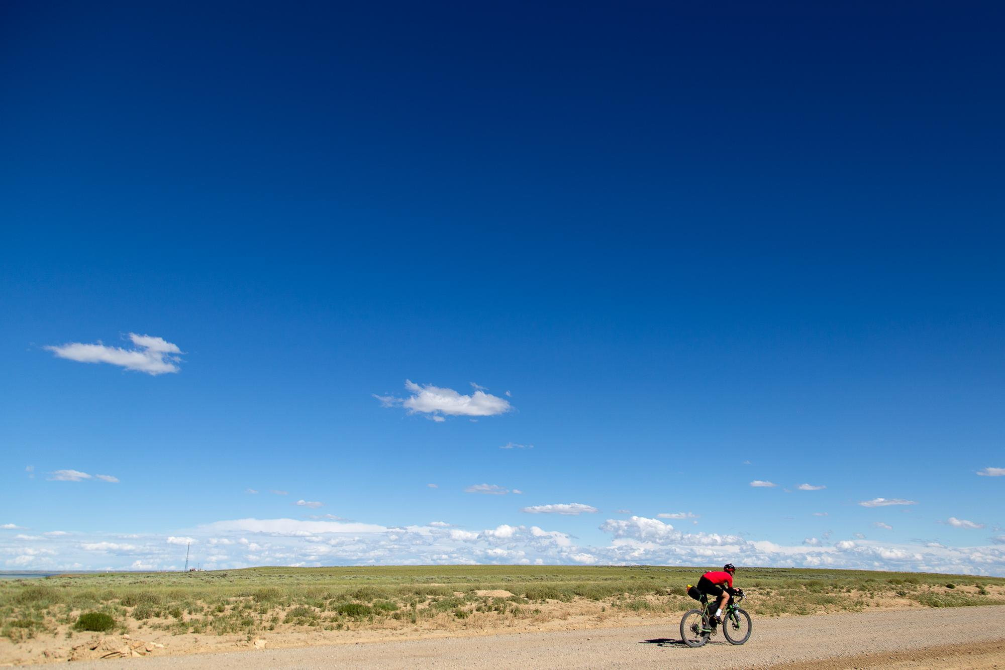 Josh Ibbett rides towards Wamsutter, Wyoming. (Rugile Kaladyte)