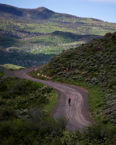 Lael riding away from Brush Mountain Lodge. (Rugile Kaladyte)