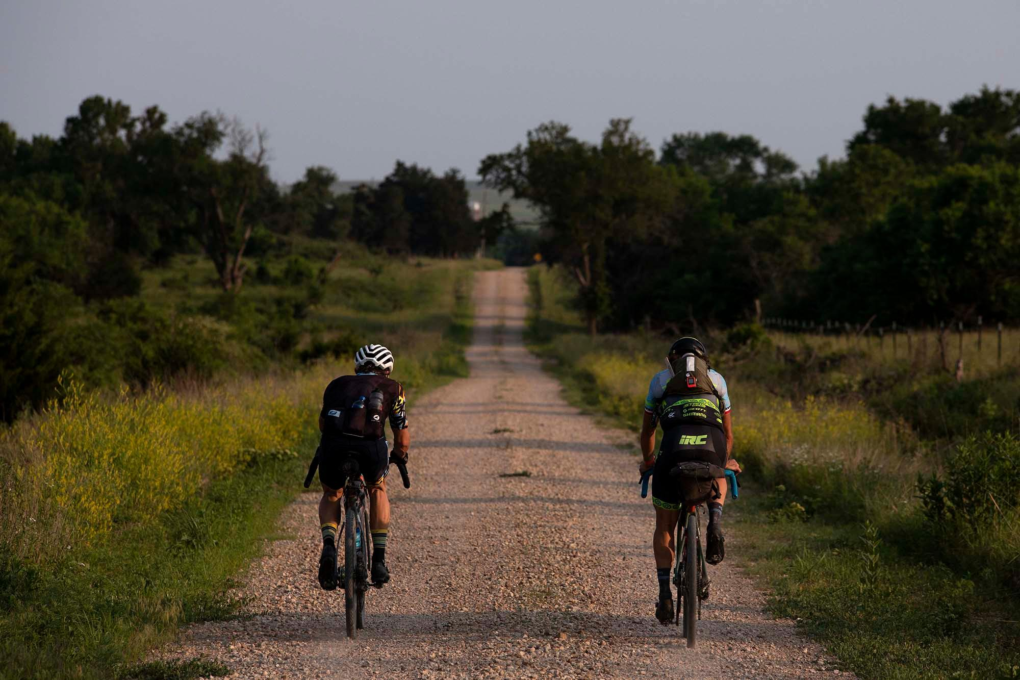 Jay Petervary and Jake Wells ride the Dirty Kanza XL. Petervary placed first with a time of 22:31:41. The course this year was 339 miles with rerouting to avoid mud. (Rugile Kaladyte)