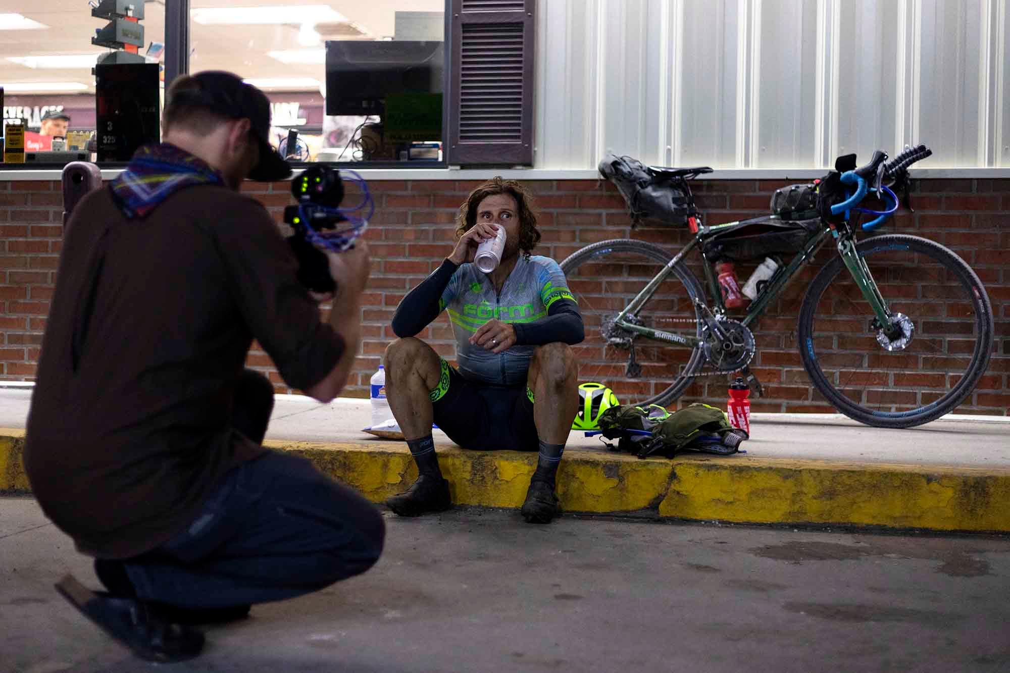 Justin Balog films Jake Wells outside of a gas station during the DKXL. Balog is working on a longer video project about Wells. (Rugile Kaladyte)