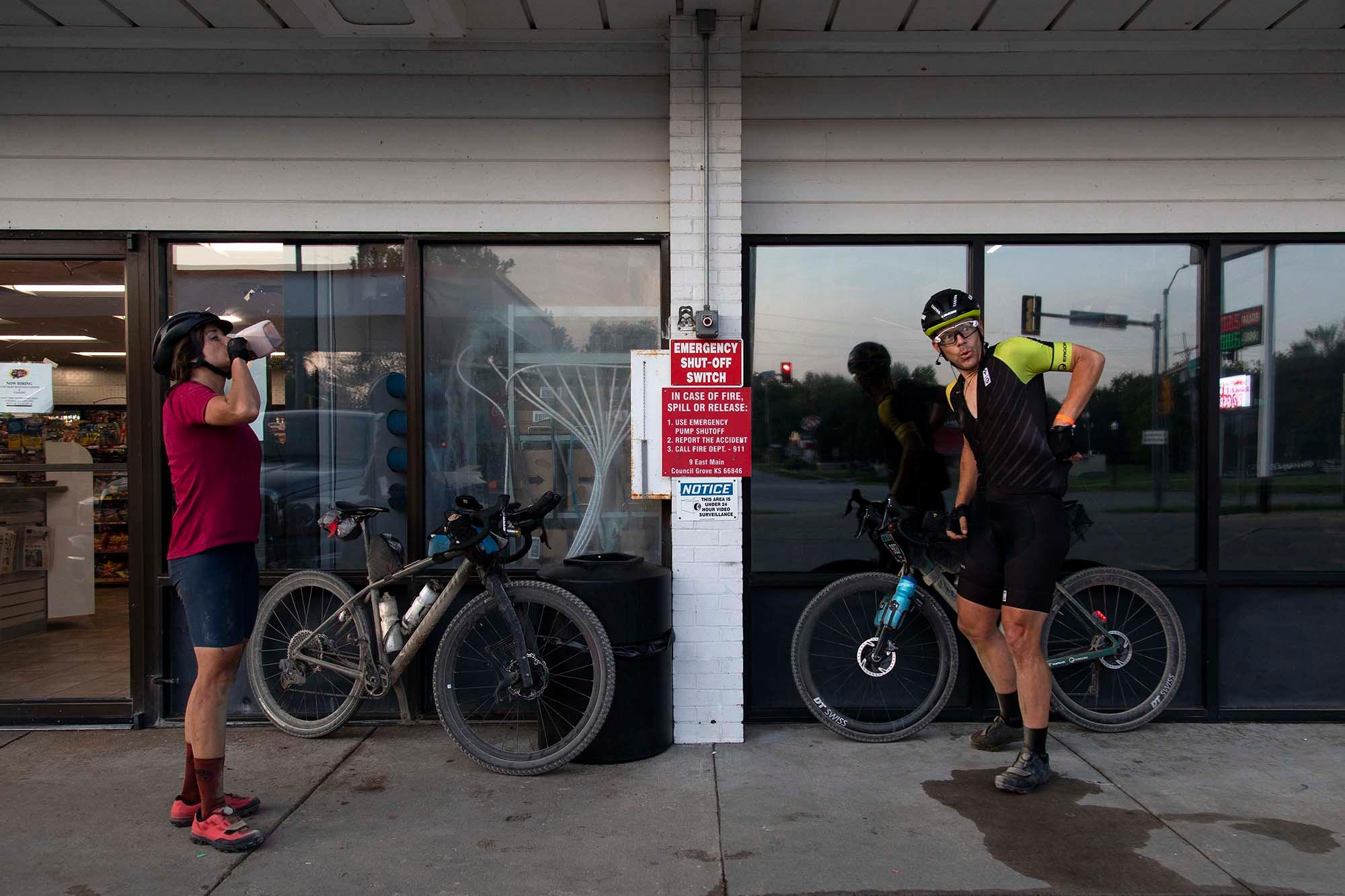 Lael Wilcox and Jeff Kerkove refuel at a gas station during the DKXL 2019. (Rugile Kaladyte)