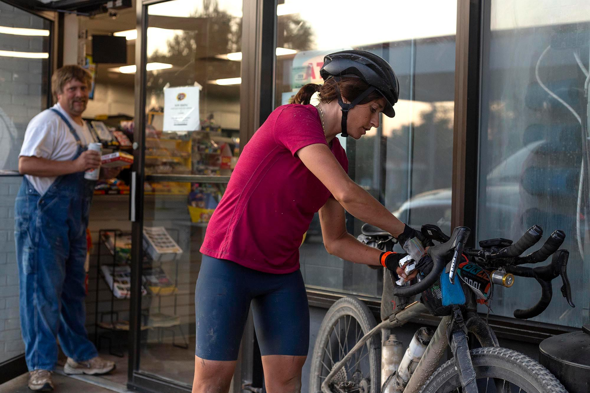 Lael Wilcox packs her bike with food during the DKXL 2019. (Rugile Kaladyte)
