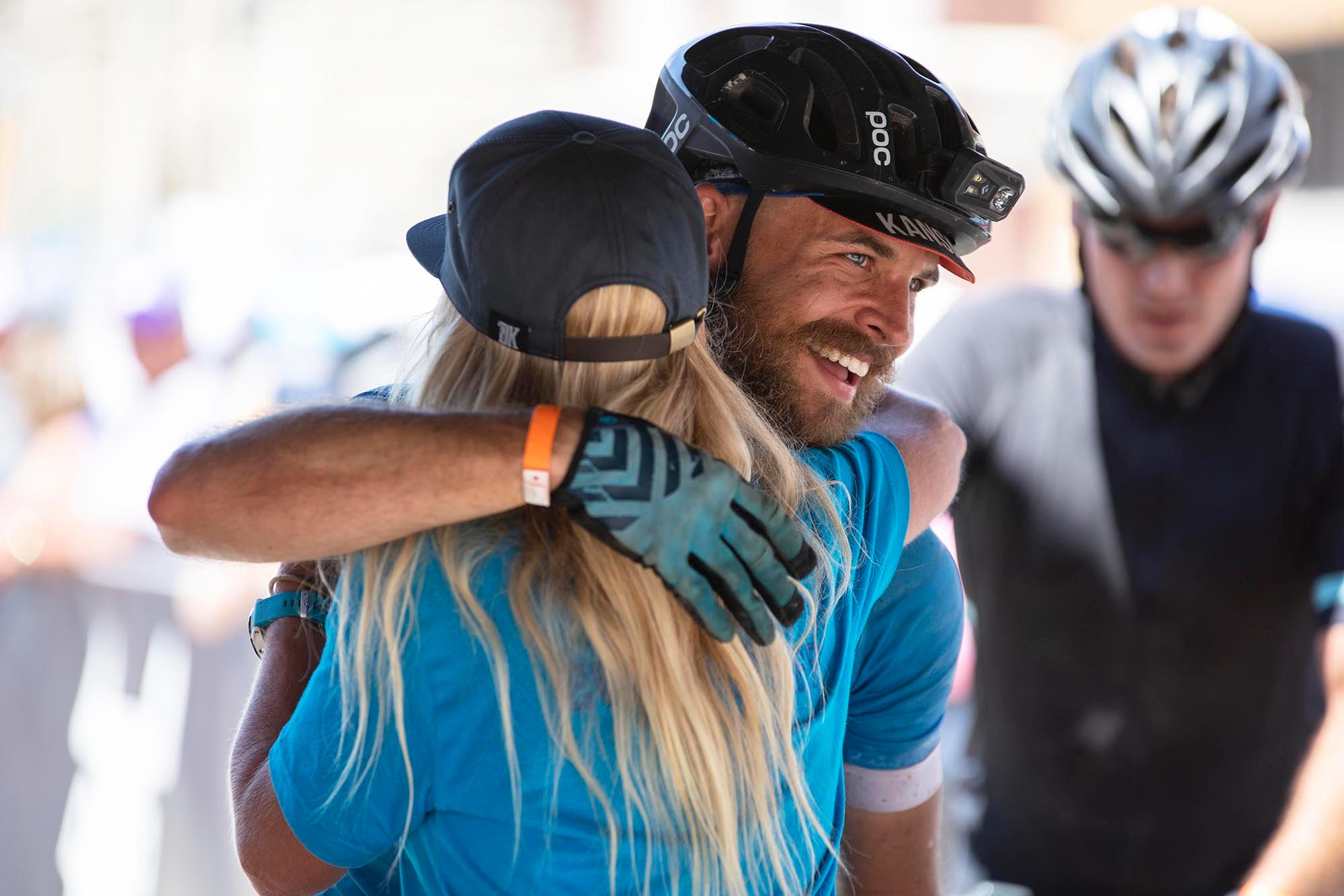 Andrew Strempke hugs Kristi Mohn at the finish of the DKXL 2019. Strempke came in fourth place with a time of 23:35:27. (Rugile Kaladyte)