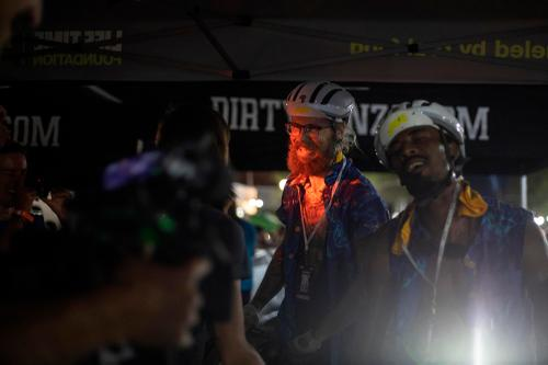 Lael Wilcox greets Benedict after his Dirty Kanza 200 finish. (Rugile Kaladyte)