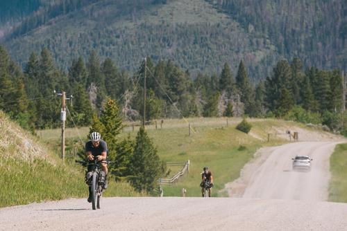 Dylan and Kim rolling into Lincoln MT on the morning of day 4 (Spencer Harding)