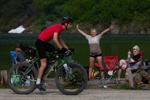 Josh Ibbet passes campers at Red Meadow Lake.(Rugile Kaladyte)