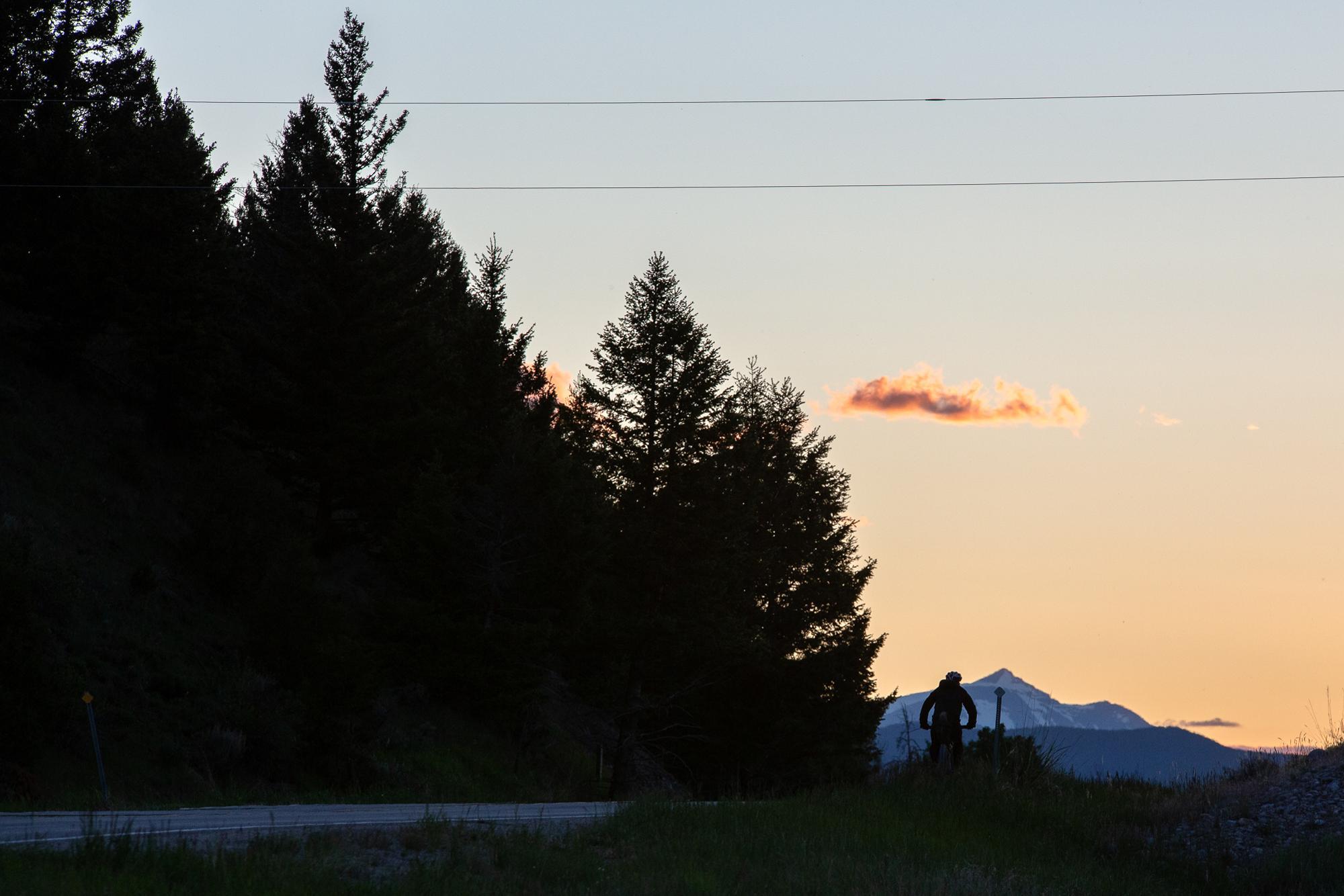 Nico Deportago-cabrera rides towards Wise River, Montana. (Rugile Kaladyte)