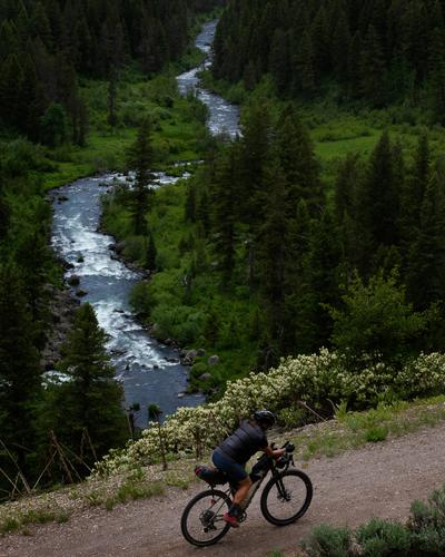 Lael Wilcox rides along the Warm River. (Rugile Kaladyte)