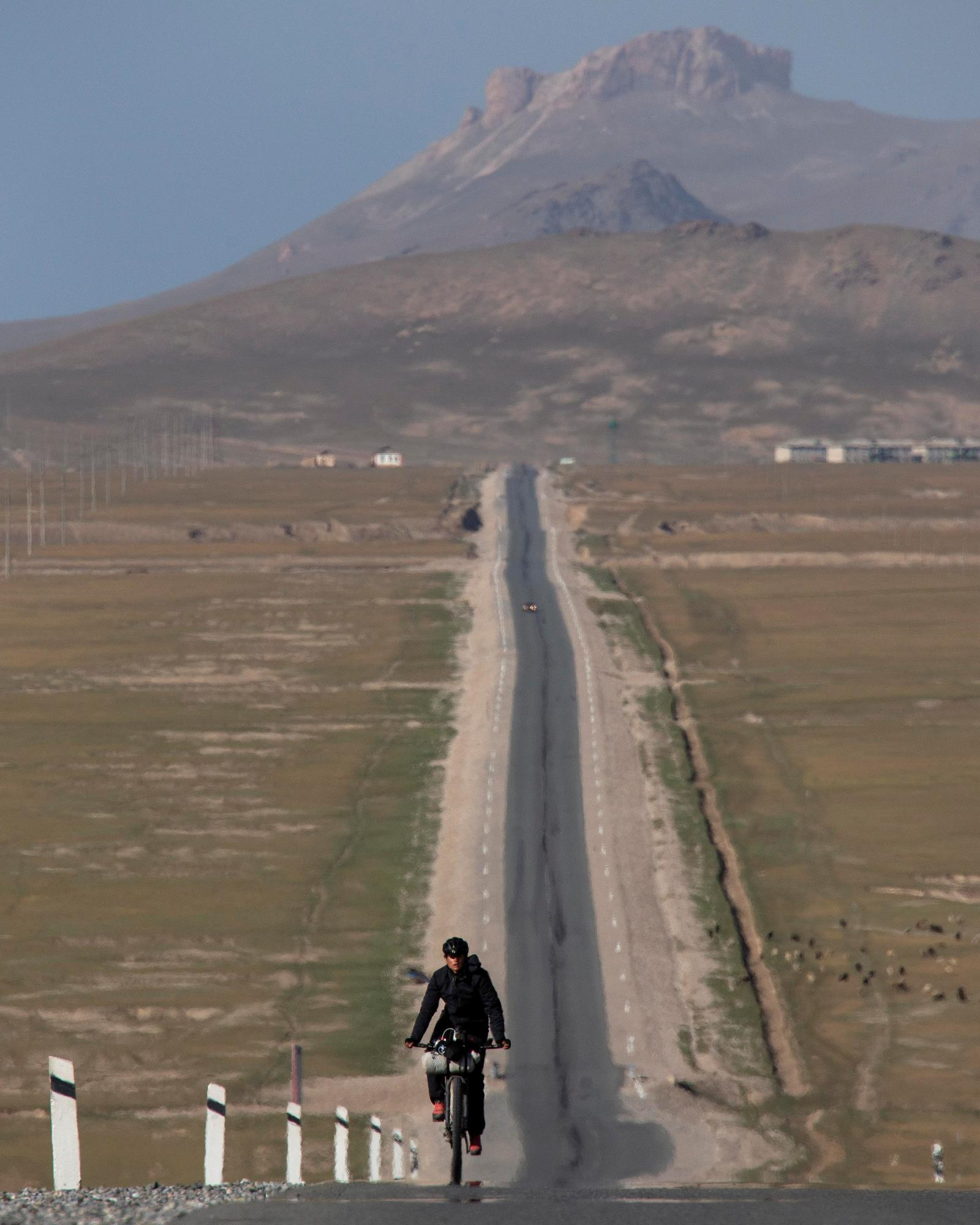 Lael Wilcox on the Chinese Highway. (Rugile Kaladyte)