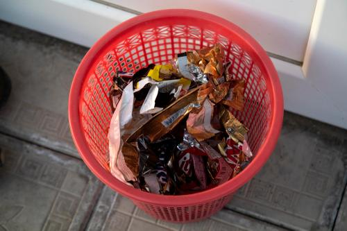 Trash can full of candy wrappers outside checkpoint three. (Rugile Kaladyte)