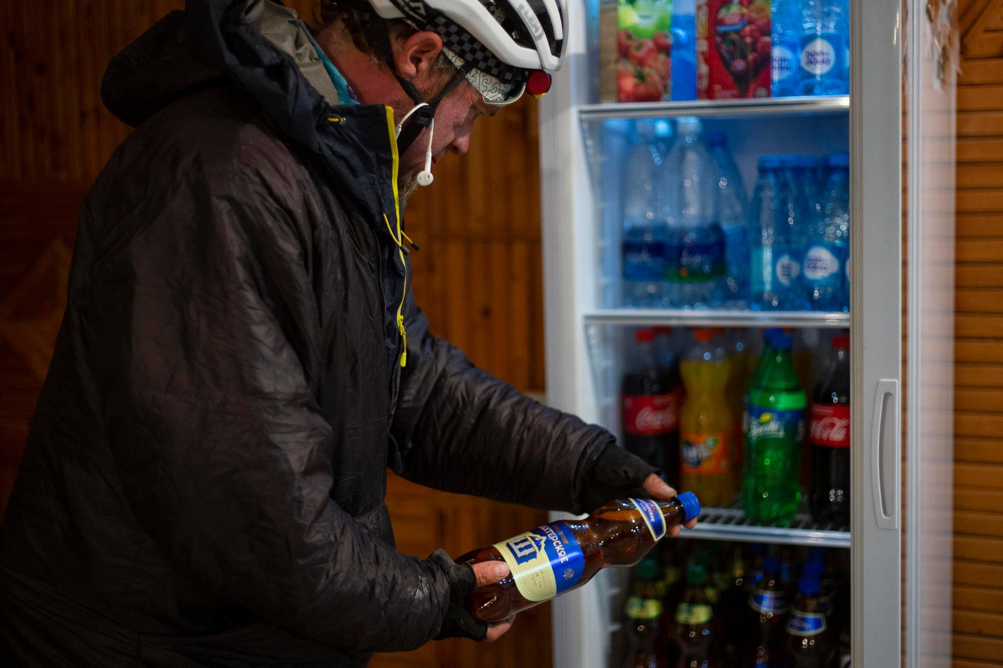 Jay Petervary selects a beer for dinner at checkpoint three. (Rugile Kaladyte)