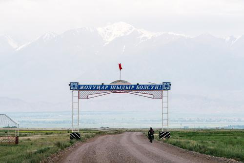 Typical signage when entering or exiting a Kyrgyz Town