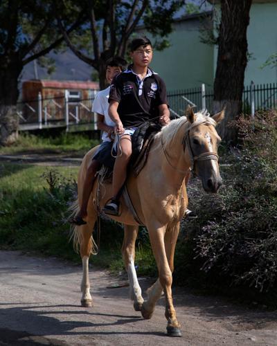 Horseback riders in Tamga, Kyrgyzstan. (Rugile Kaladyte)