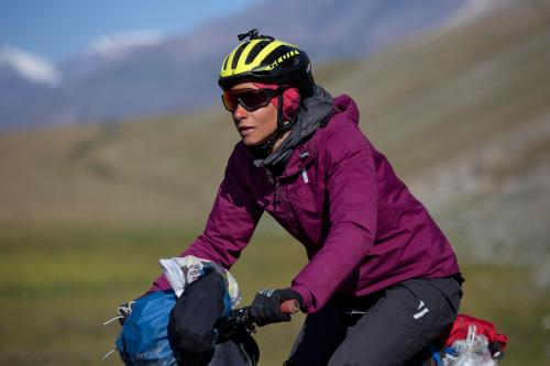 Sue Paz Thunstrom rides towards checkpoint three. (Rugile Kaladyte)