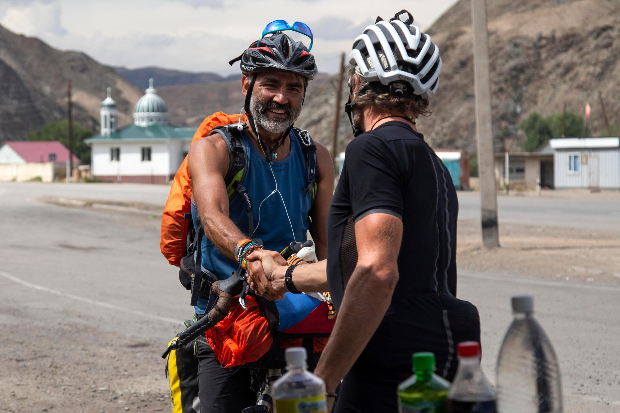 Jay Petervary meets a fan before descending into Kochkor. (Rugile Kaladyte)