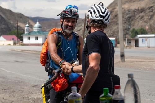 Jay Petervary meets a fan before descending into Kochkor. (Rugile Kaladyte)