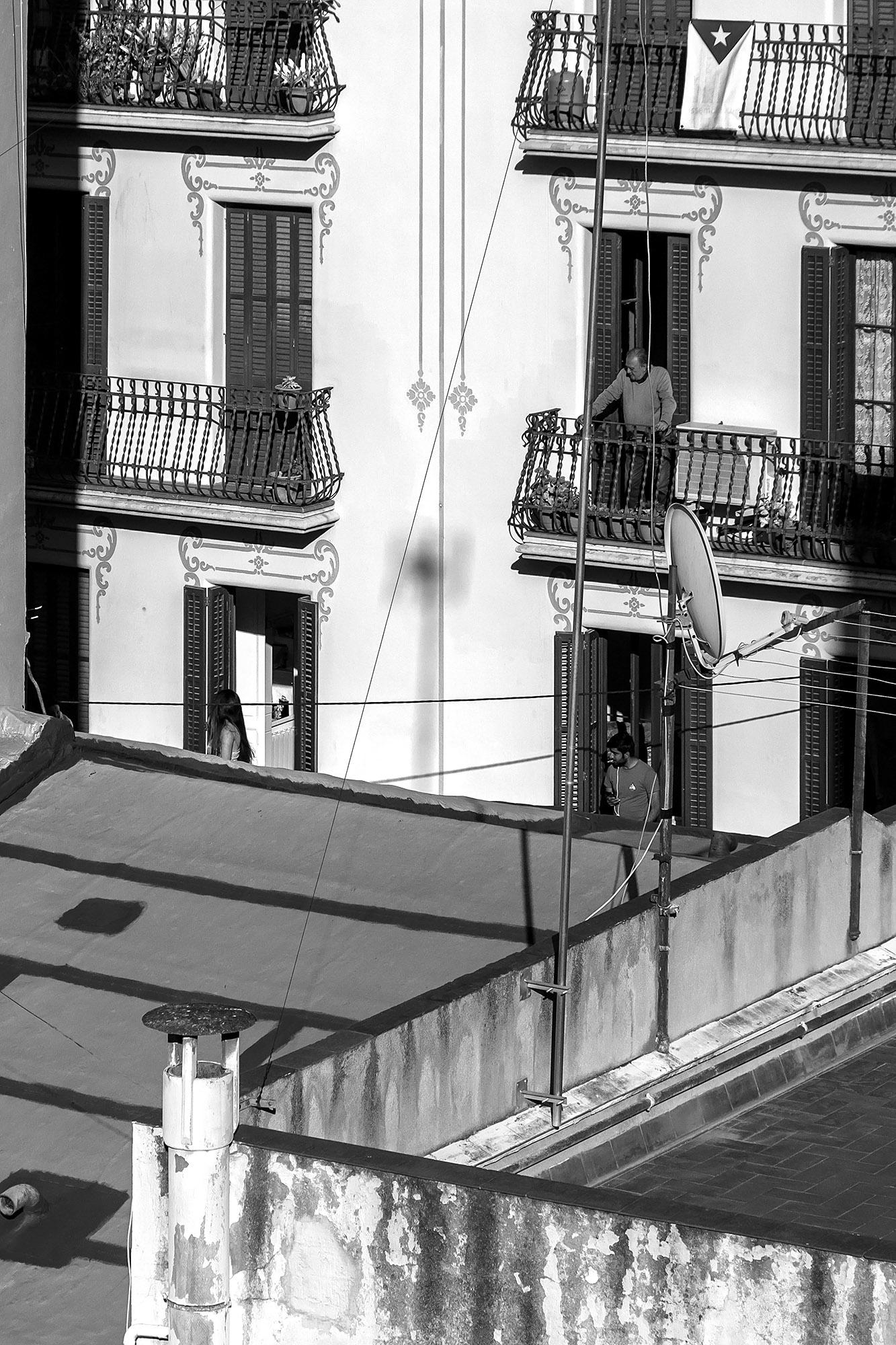 Lockdown Boredom: Neighbors on a balcony across the neighborhood.