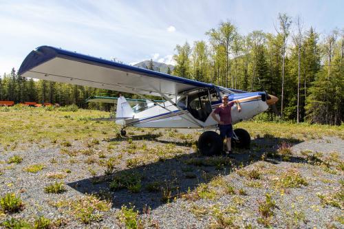 Anson Moxness with his plane outside of Hope, Alaska. (Rugile Kaladyte)