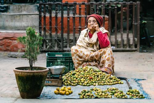 Street vendor enjoying a smoke