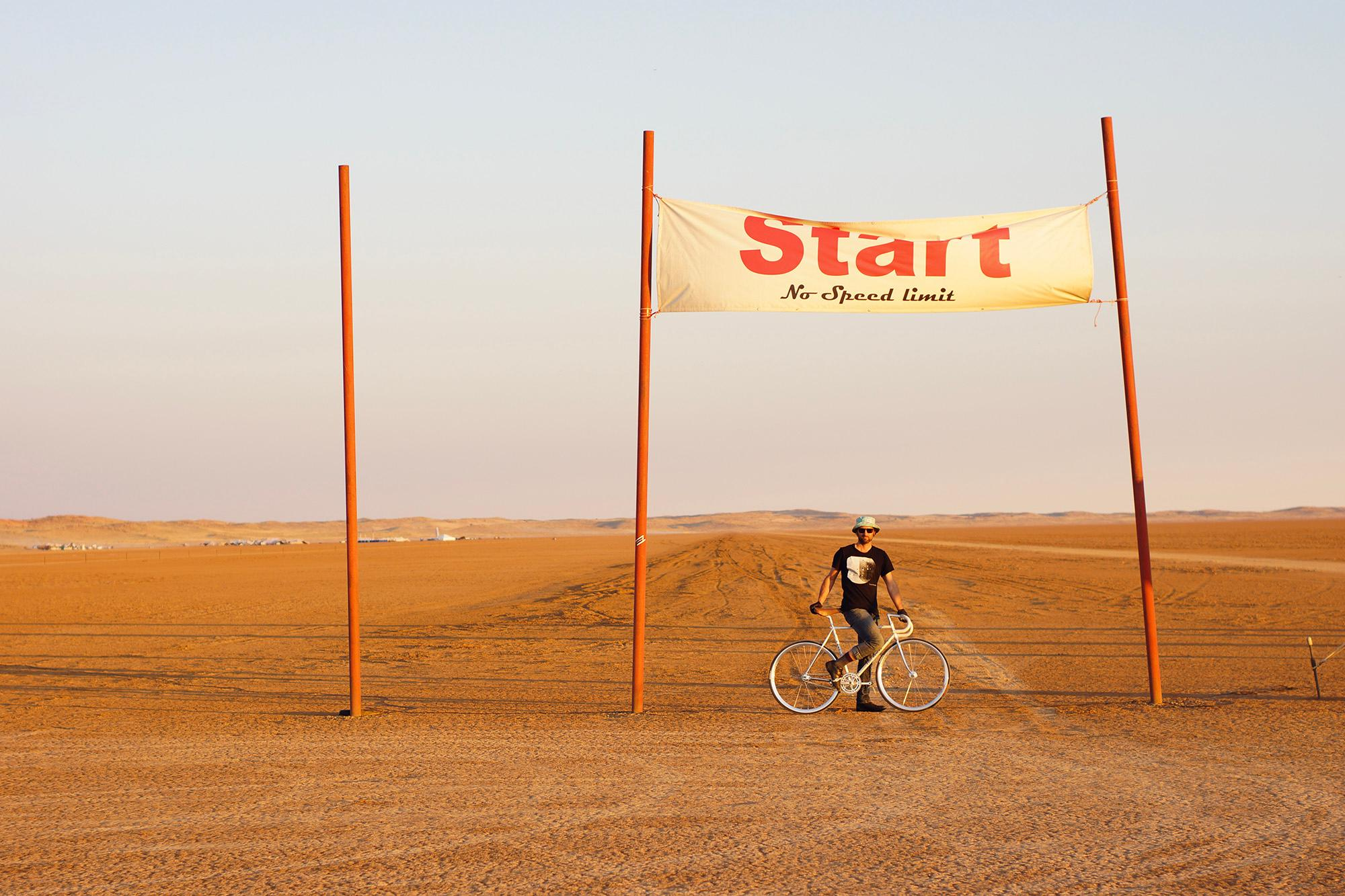 Nic at the 2014 Speedweek start line, with the Hakskeenpan base camp in the background.