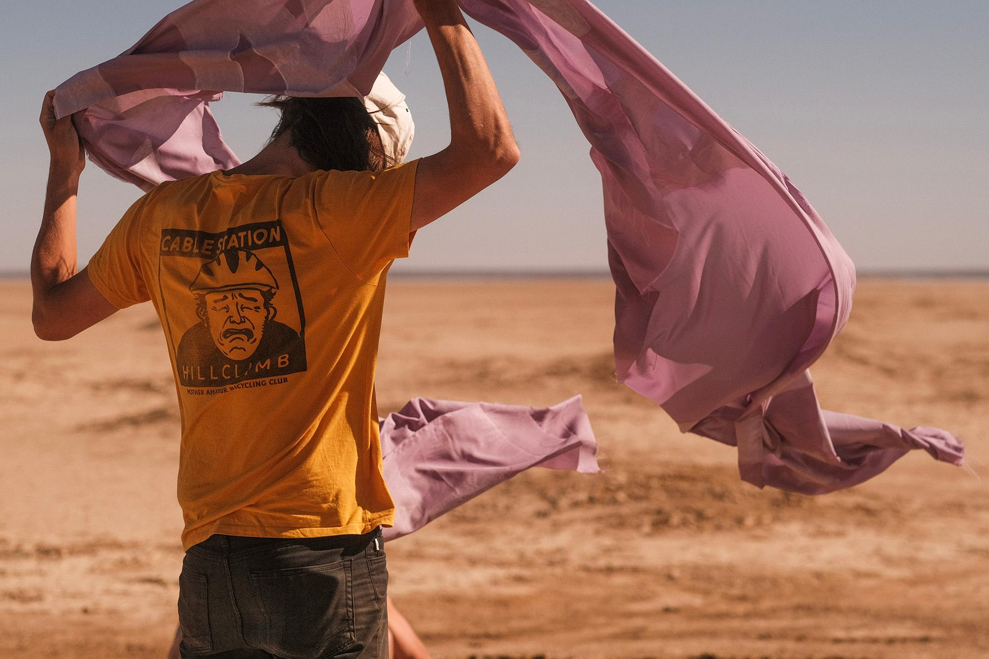 Jared wrangling the finish line - it's getting windy. DUST, Verneukpan, 2020.