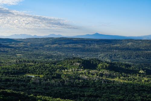 The La Sal Mountains stand on the horizon.