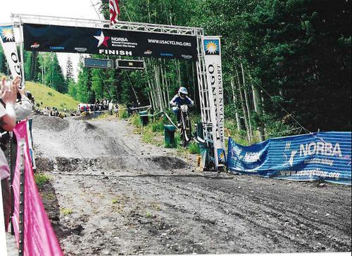 Kathy finishing in style at a NORBA National in Durango, CO.