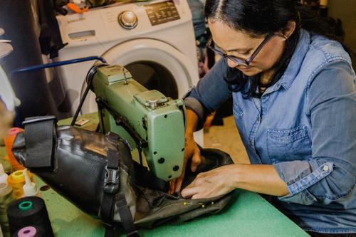 9. Irlanda repairing my Salsa seat bag that had become unseamed_